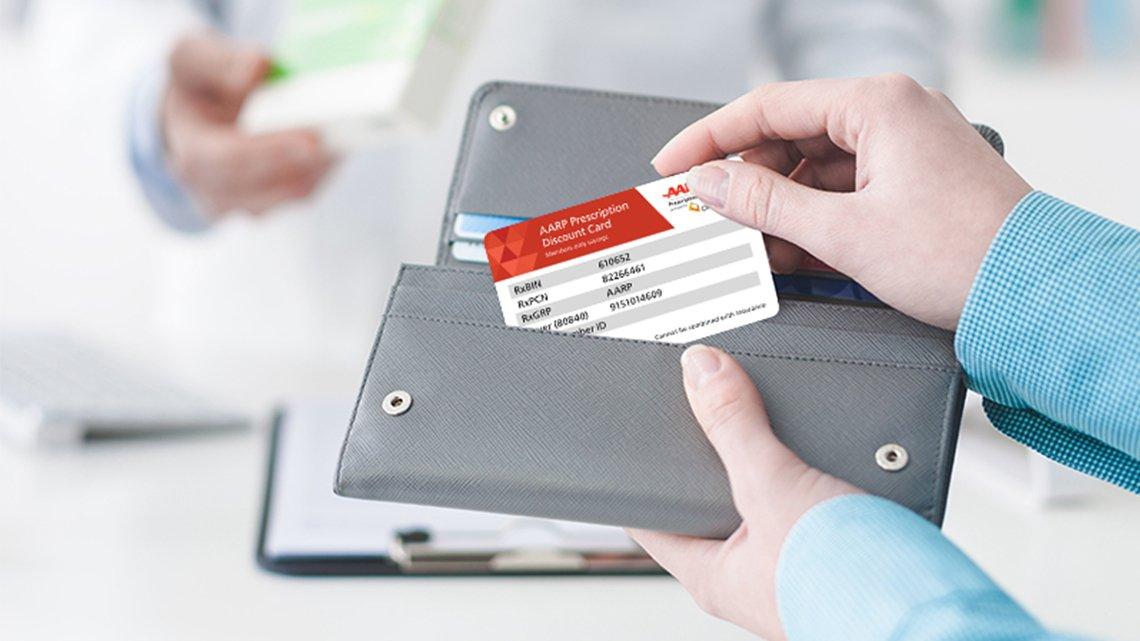 woman holding grey wallet, aarp card