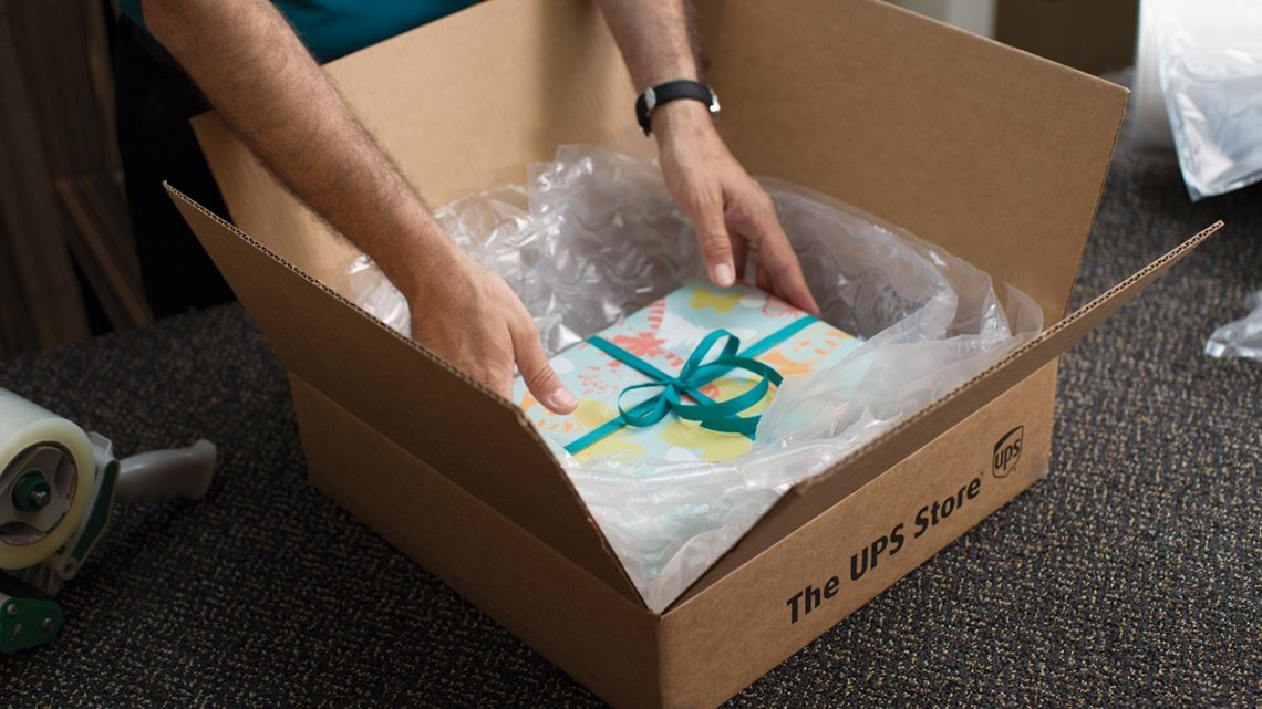 hands gift box ups box