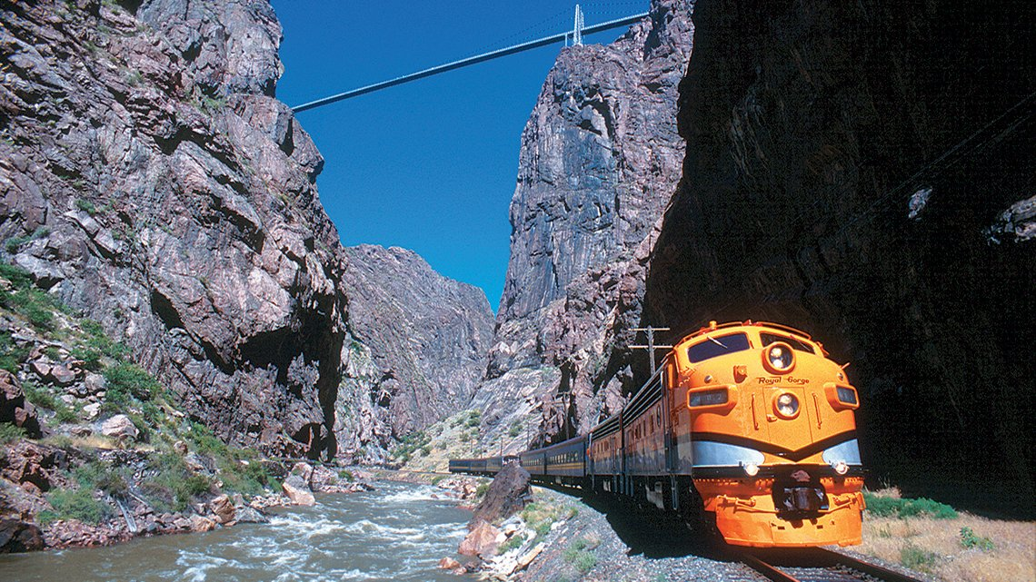 Colorado, Train in rocky canyon by river