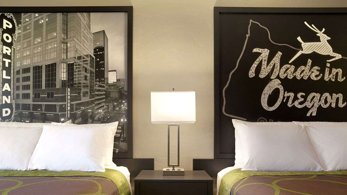 Interior view of double beds and  nightstand at Super 8 property