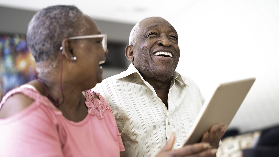 Senior couple using digital tablet