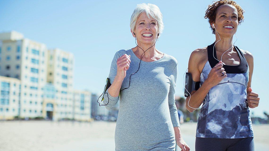 Two women jogging on beach