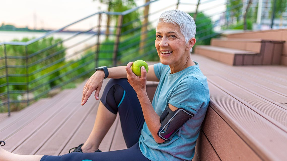 Woman with apple on porch