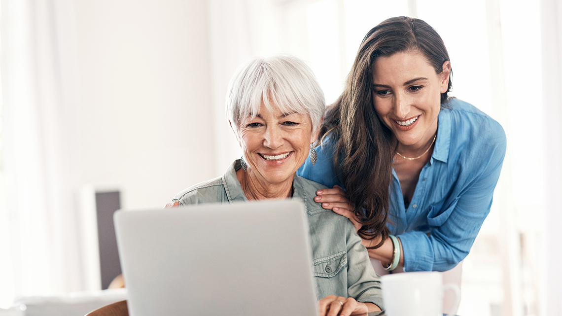 Mom daughter smiling laptop