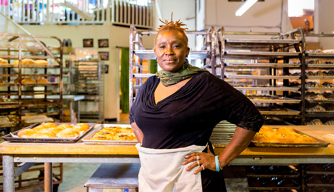 african american woman with hands on hip in bakery
