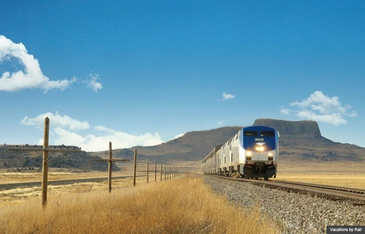 Train passes through prairie, Vacations by Rail (Vacations by Rail)