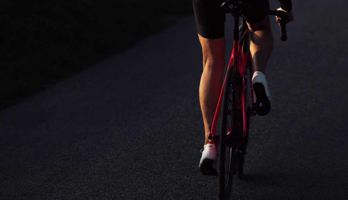 close up of the feet of a person cycling