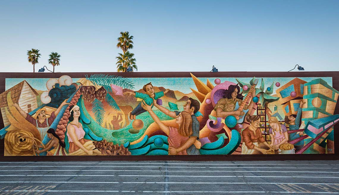 a large mural on an outdoor wall