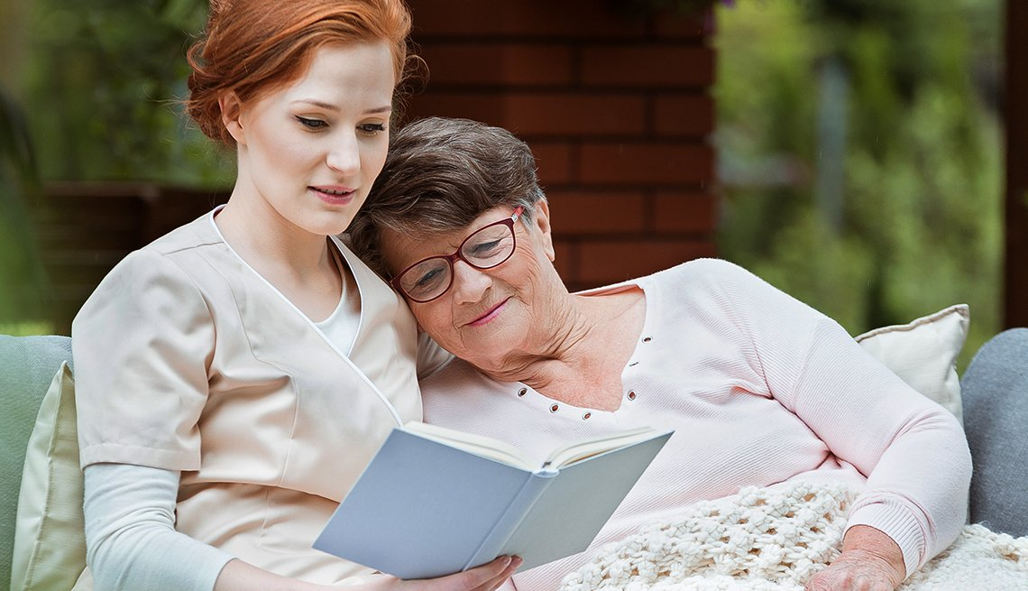 mature mother and daughter read a book