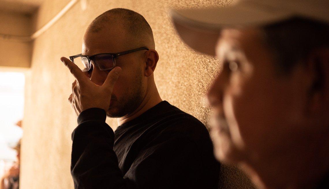 item 3 of Gallery image - Comedian Jesus Treo, wiping his eyes.