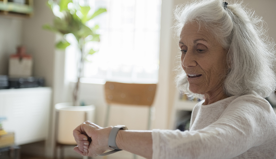 Woman looking at her smartwatch