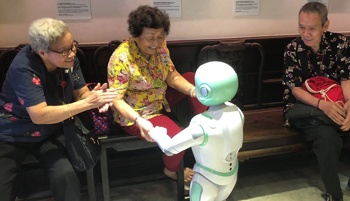 Woman dancing with iPal robot