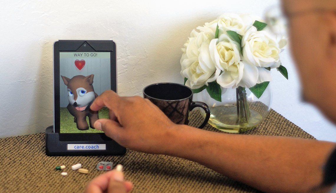 Man using a GeriJoy virtual pet
