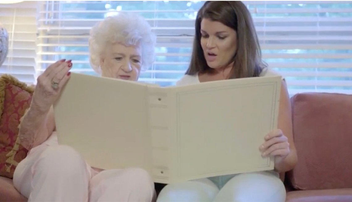 Two women looking at photo album
