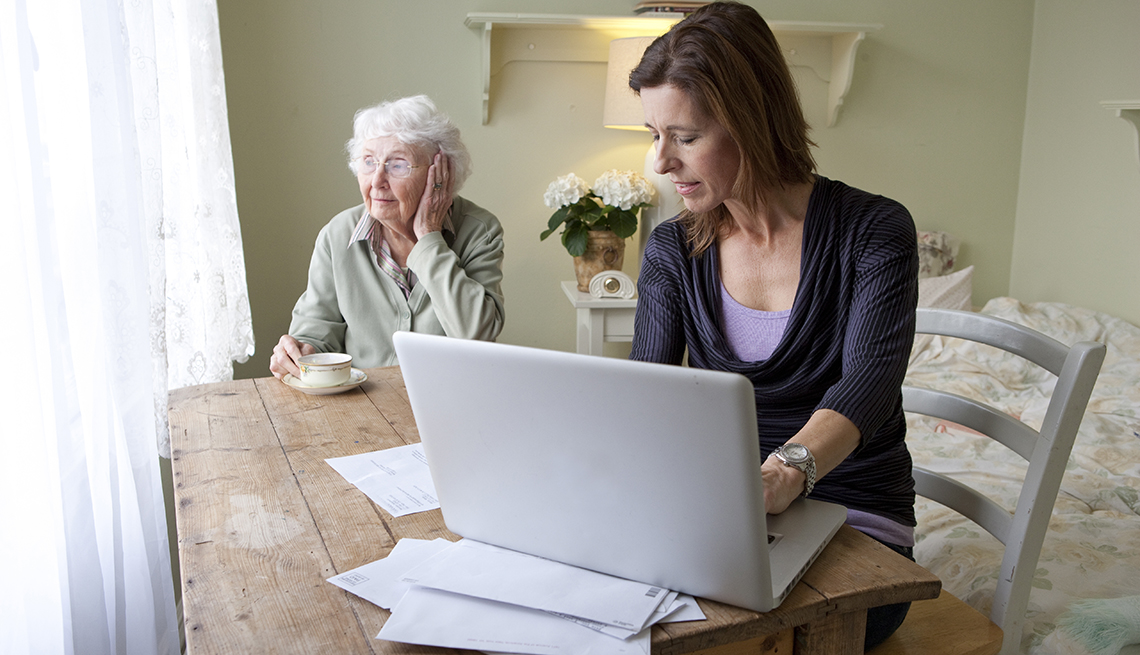 Woman working from home while caregiving for mother