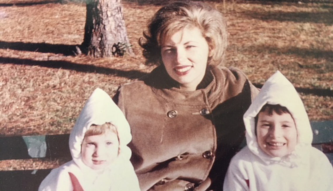 Annabelle Gurwitch as a young child, sitting in the park with her mother and sister