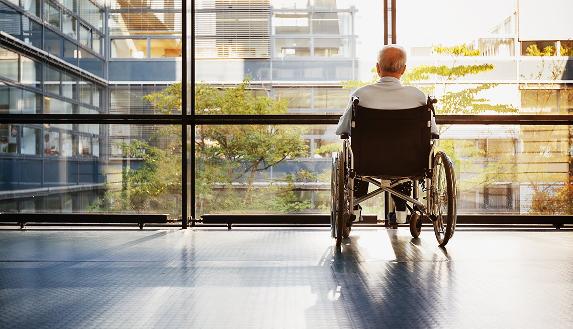 Mature male at a nursing home facility looking out the window