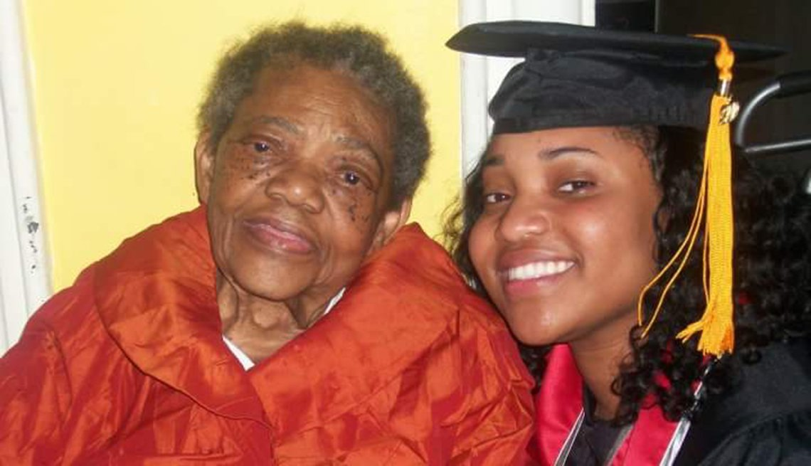 Jazmine in a graduation gown with her grandmother