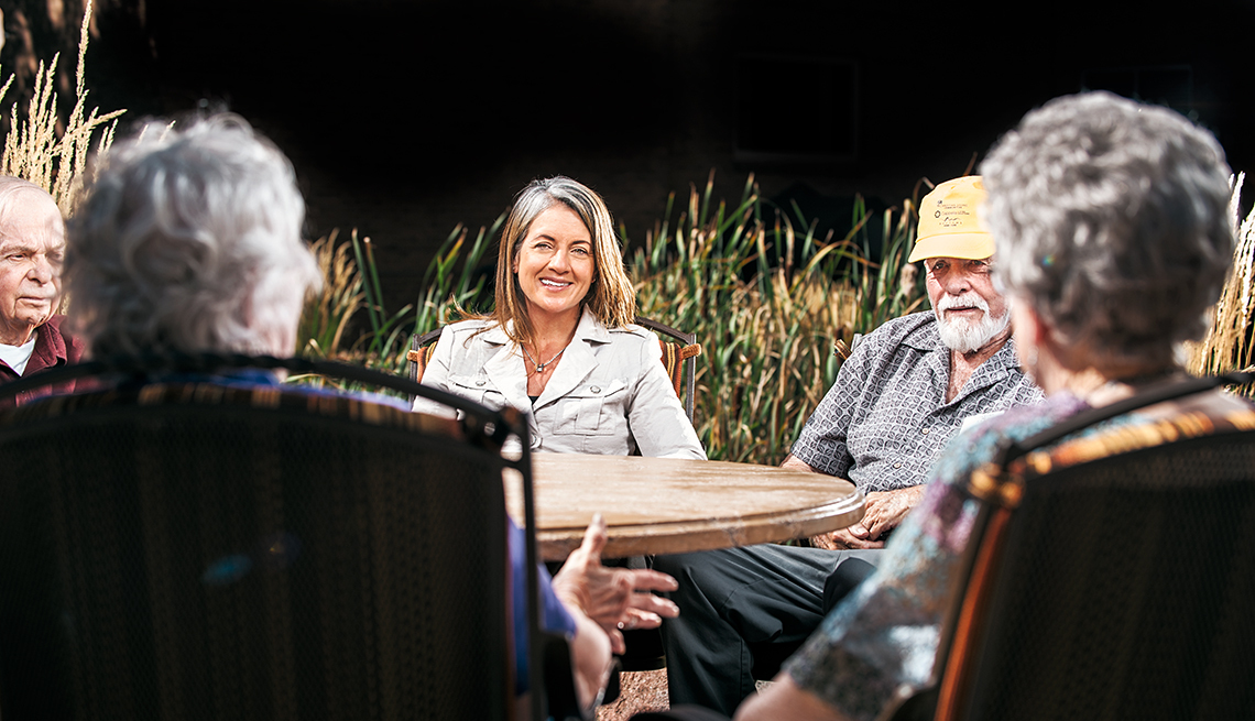 Senior living expert Jill Vitale-Aussem sitting at a table with older adults