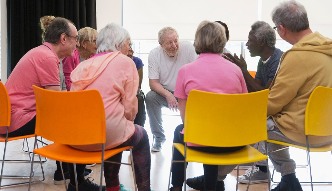 Group of older people sitting in chars in a support grop