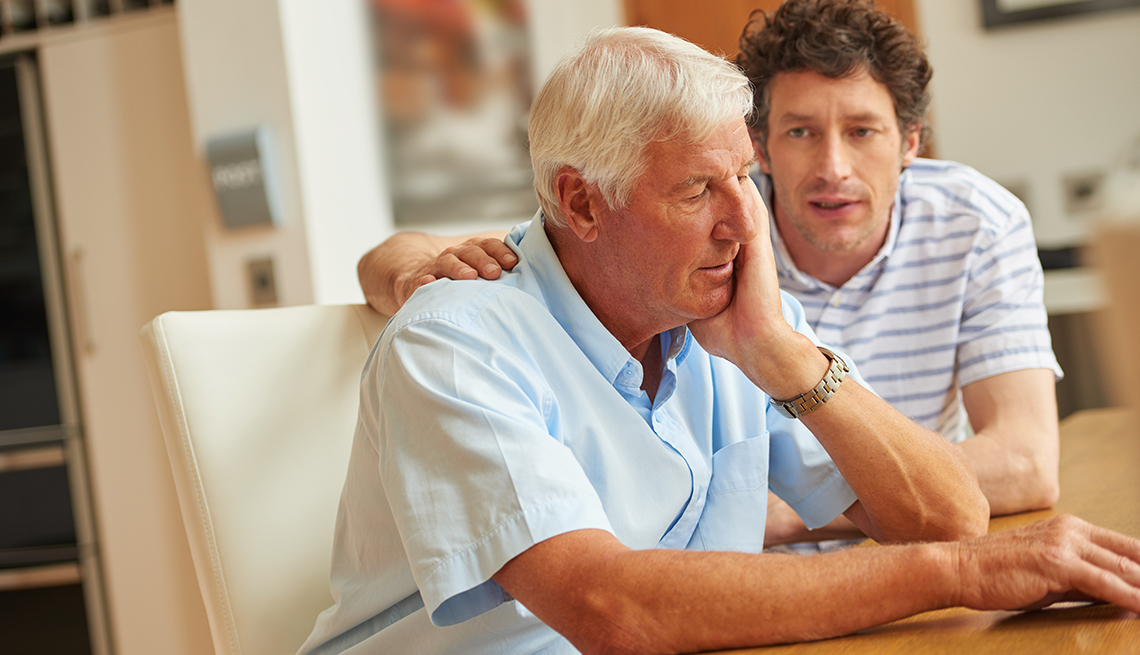 Adult son having a serious conversation with his aging father