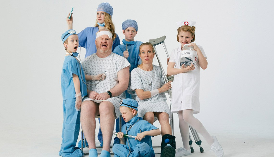 Jeannie and Jim Gaffigan dressed in medical gowns with their five children all dressed up as doctors and nurses