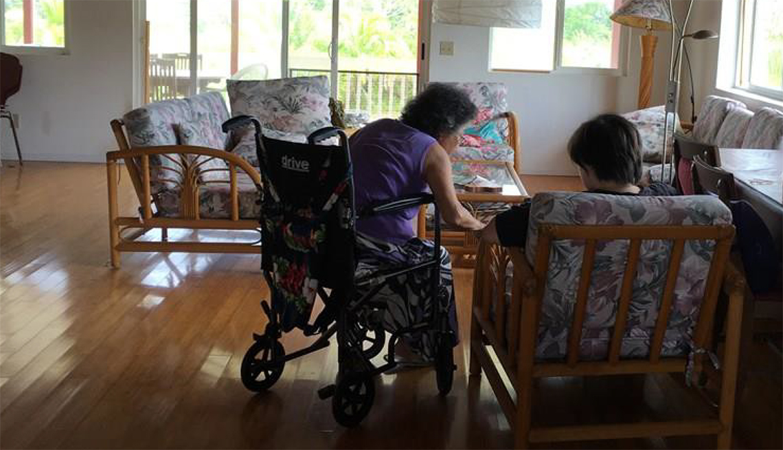Frances Kai-Hwa Wang's mother and daughter sitting in the living room going over bills to be paid.
