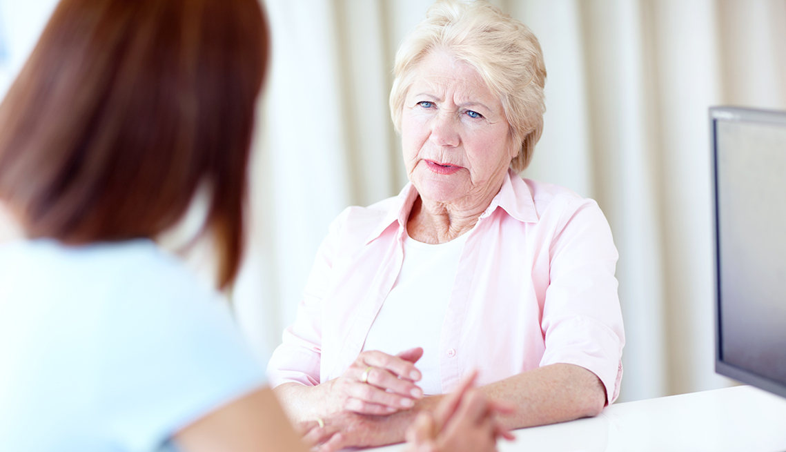 Concerned looking woman speaking with a female long-term care ombudsman