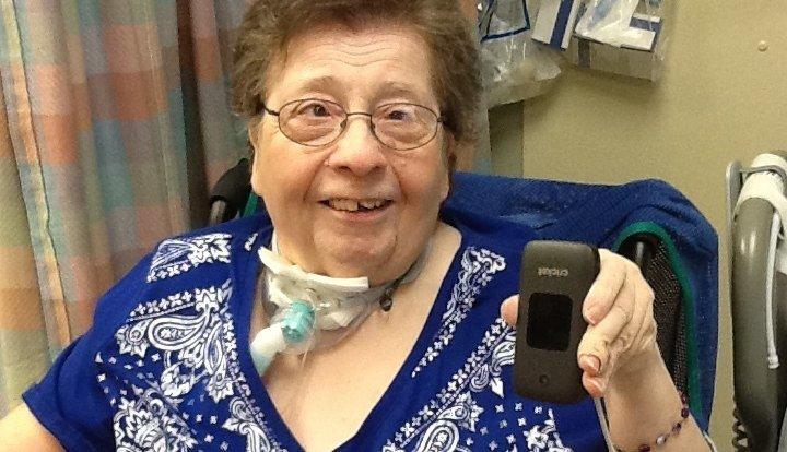 ronni ehrhart in her nursing home room holder her new smart phone