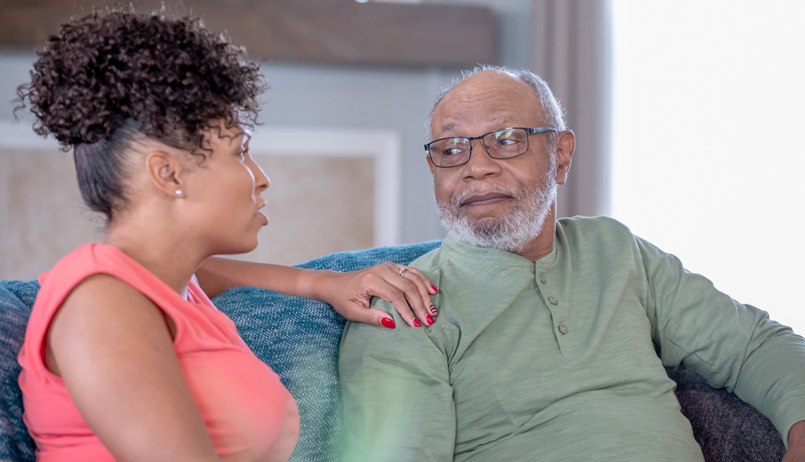 Woman having a serious talk with her father