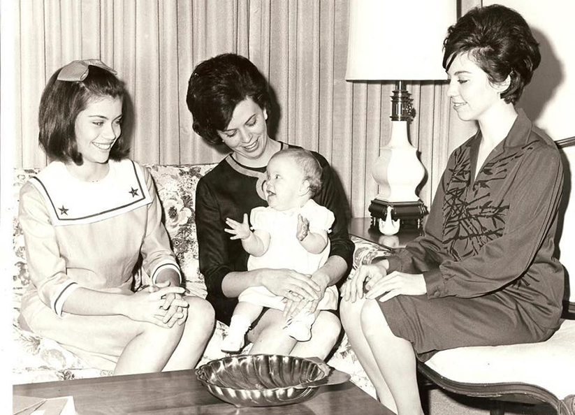 Alison Lolley on her mother's lap in 1964