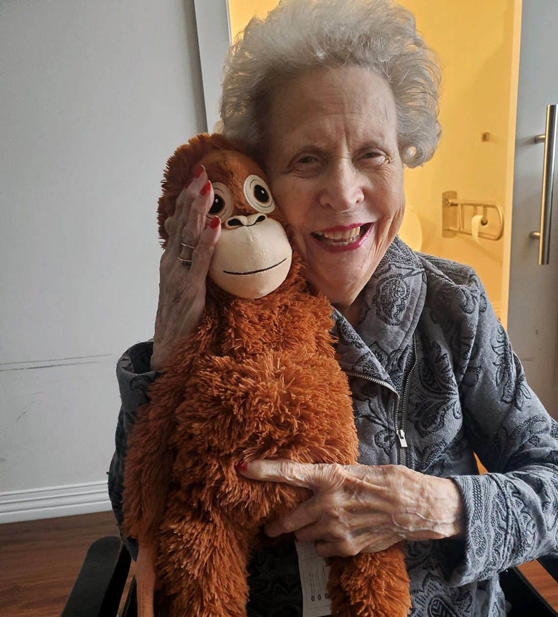 Wilma holding  a stuffed animal monkey