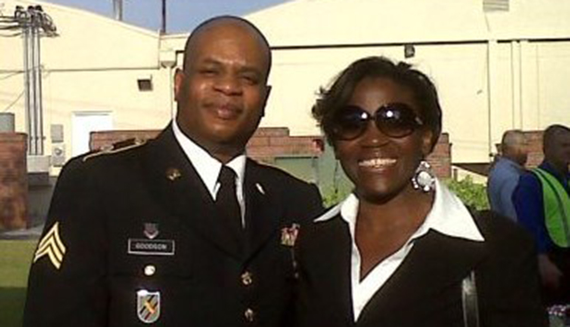 Precious Goodson with her husband wearing a military uniforms