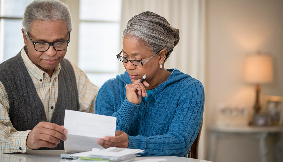 A couple looking through retirement planning paperwork