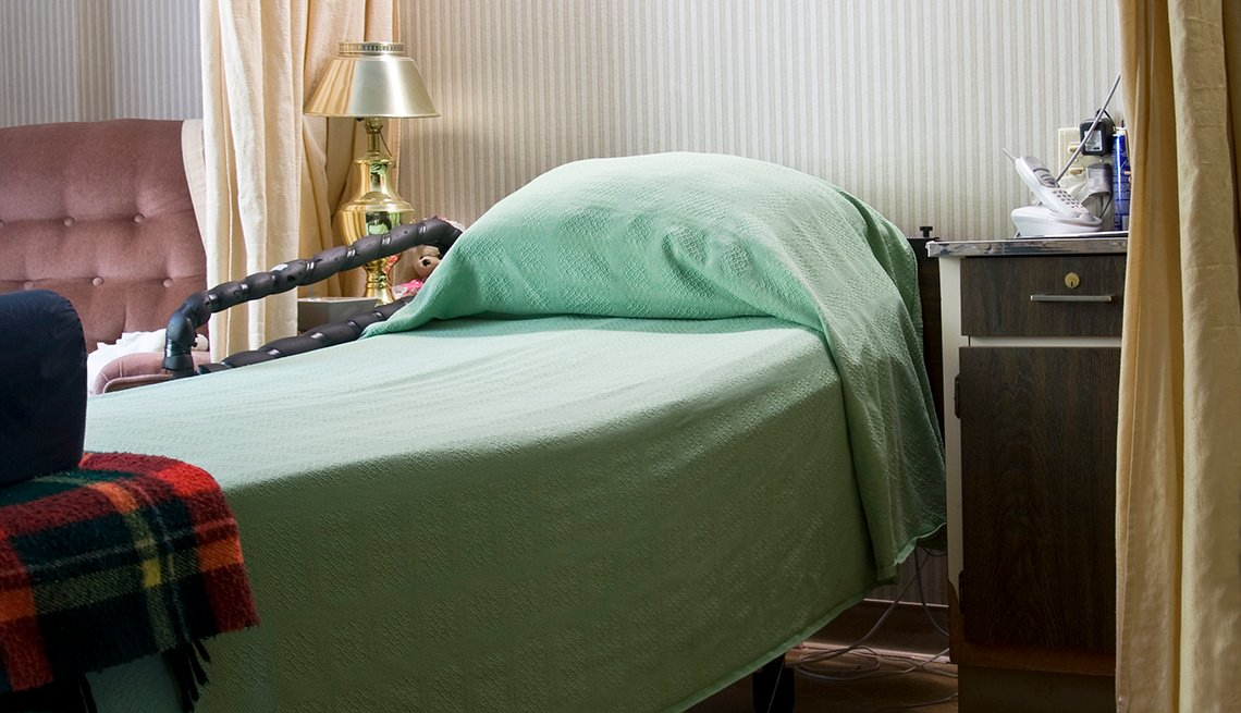 An empty bed in a nursing home