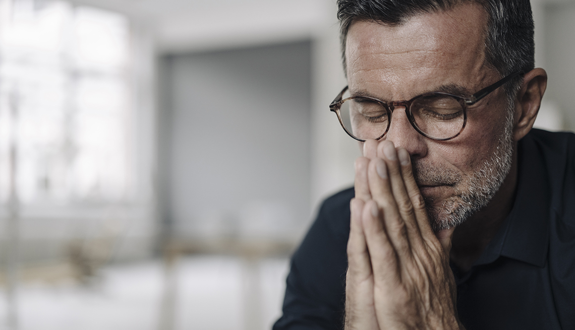 a stressed looking male family caregiver
