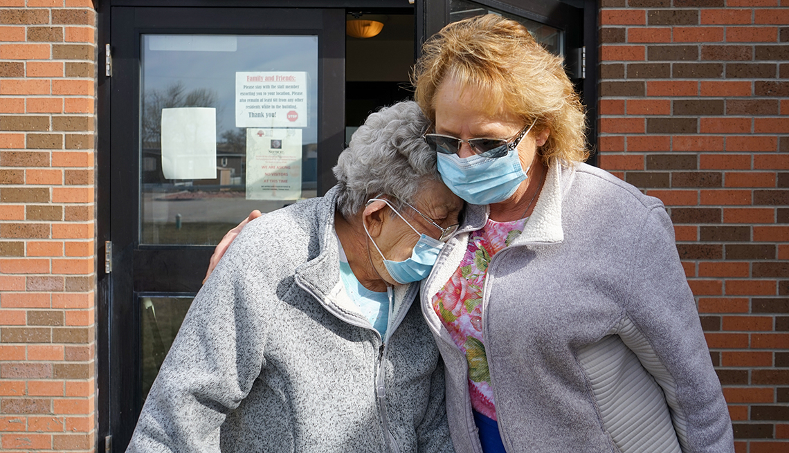 resident karen krause embracing her daughter as they leave her nursing home
