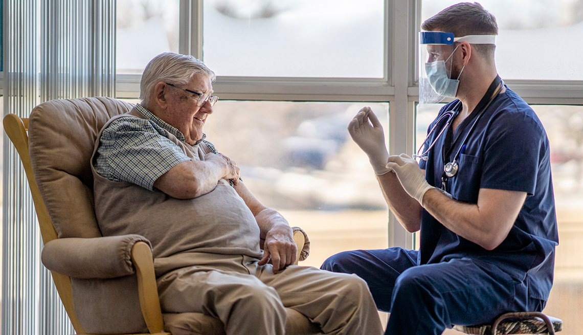 A nursing home resident getting a covid 19 vaccination
