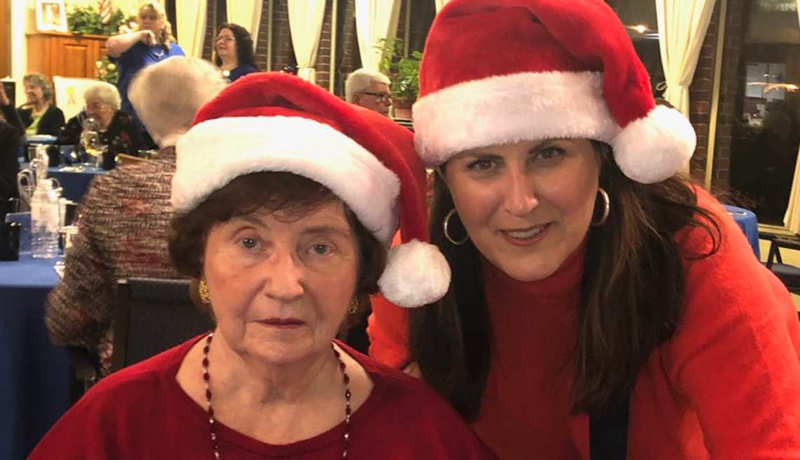 Maureen Clark Newlove with her mother, Maureen Clark, 86, at a holiday party in the nursing home.
