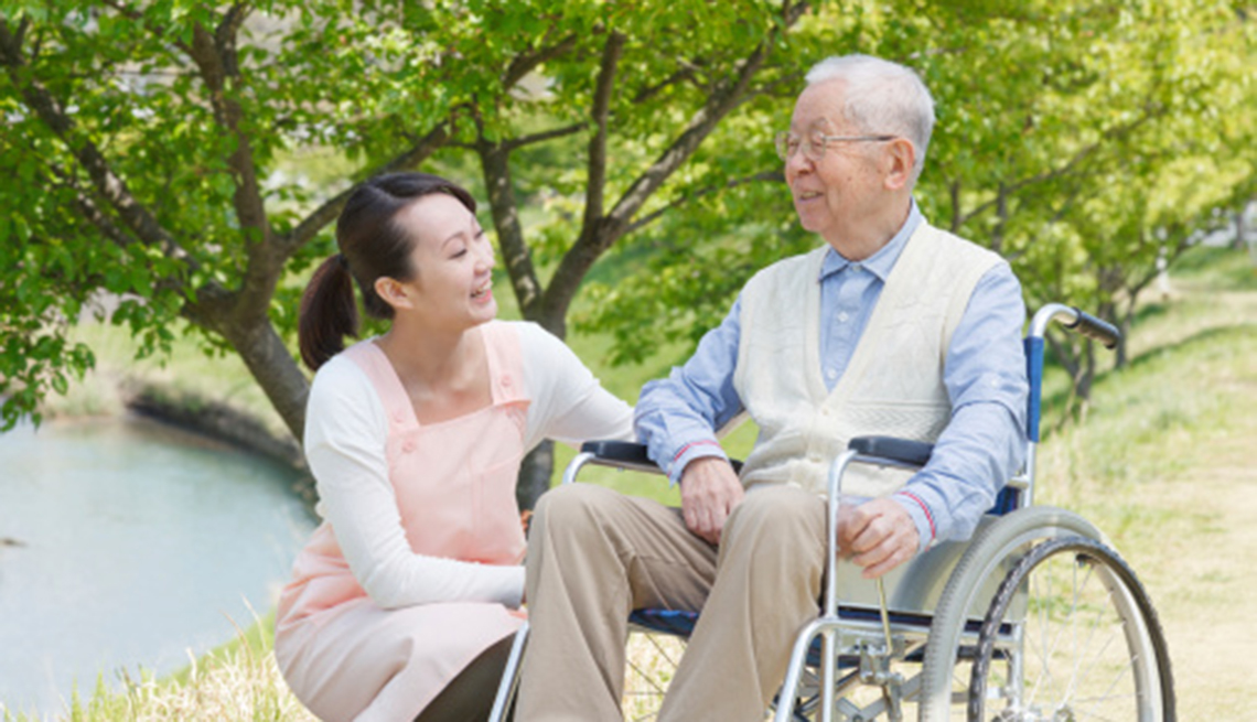 man in wheelchair and his caregiver or friend