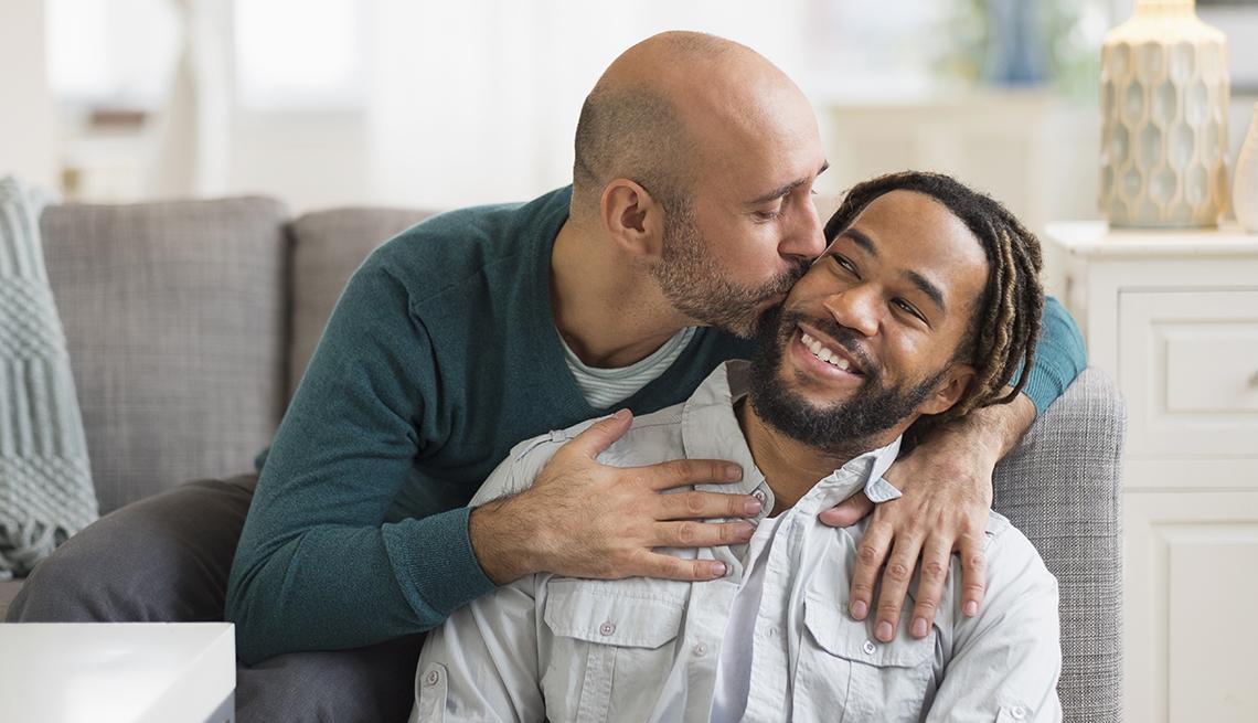 man kissing his partner at home