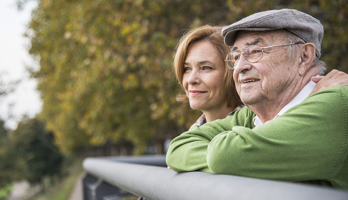Older man looking at scenery with daughter