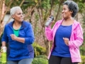 Two senior black women power walking