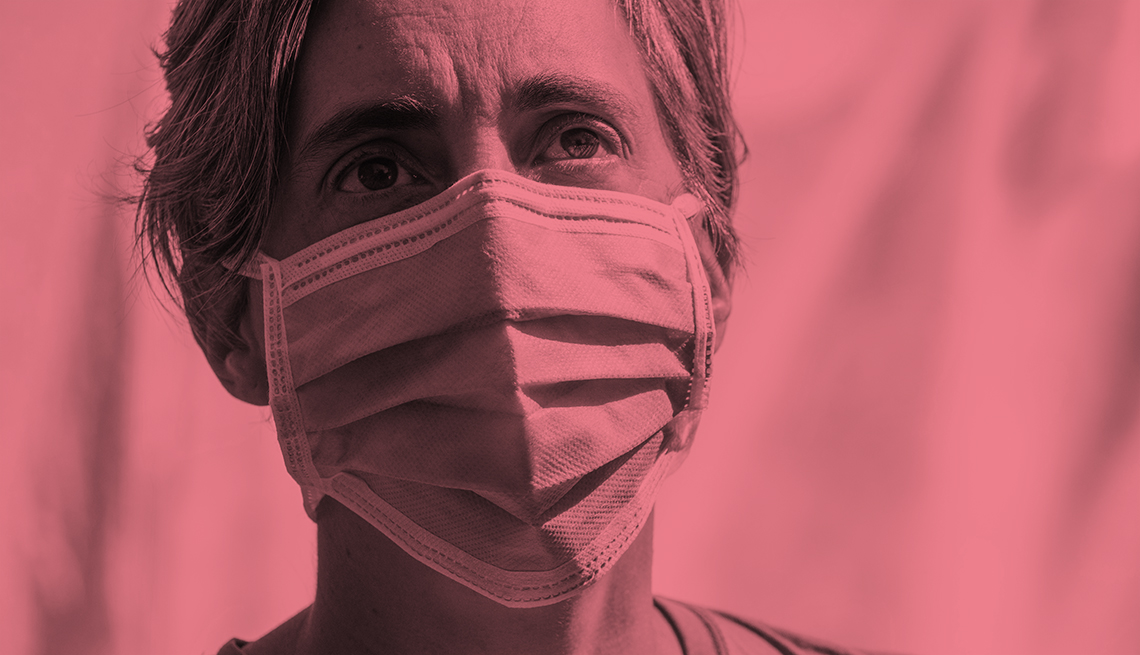 a woman wears a face mask as protection against coronavirus