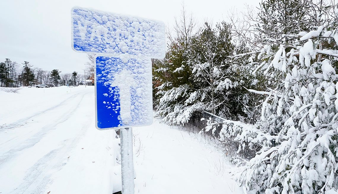 snow covered vaccines sign