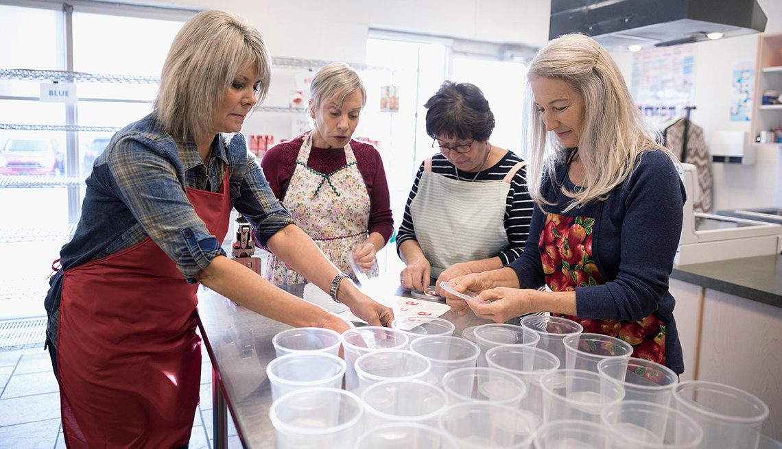 Female volunteers cooking in soup kitchen