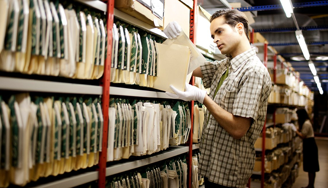 Man handling archived material