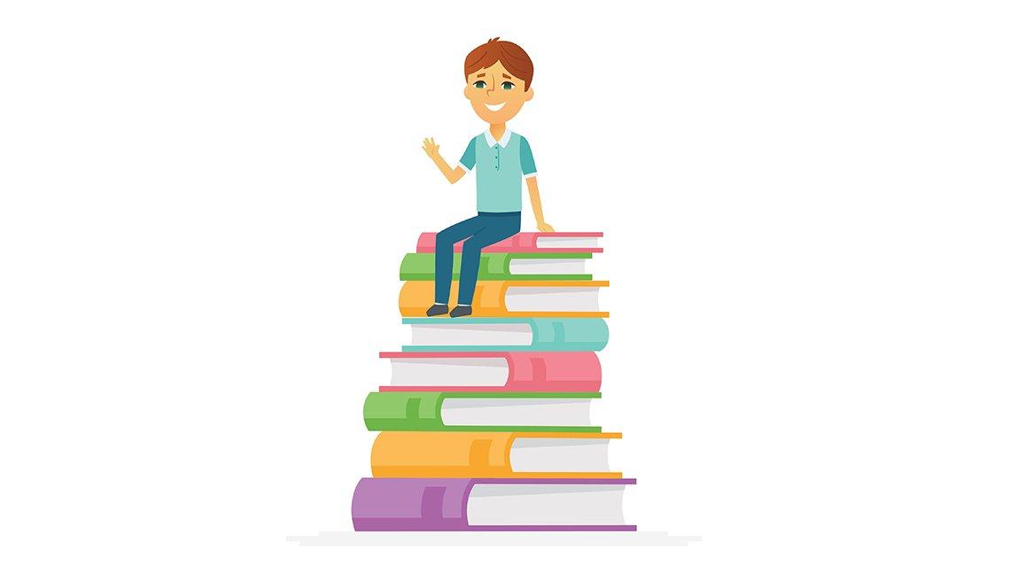 Boy sitting on books