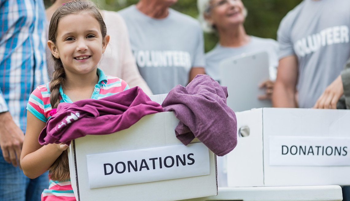 Girl holds donation box