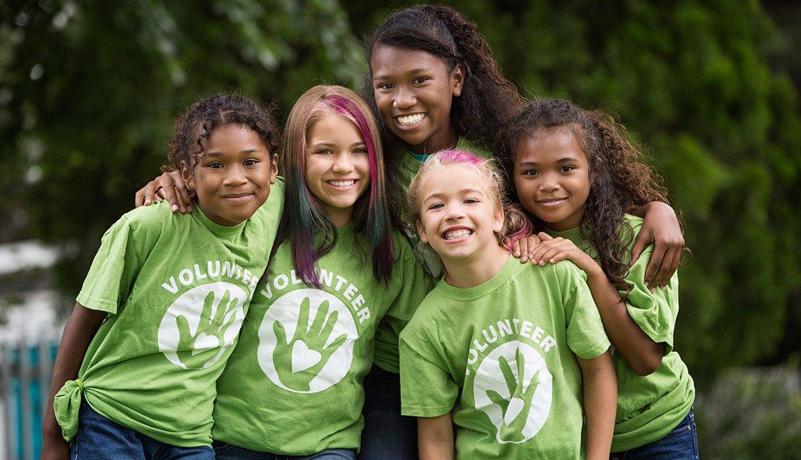 Girls wearing volunteer shirts